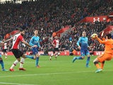 Charlie Austin scores the opener during the Premier League game between Southampton and Arsenal on December 10, 2017