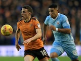 Diogo Jota of Wolverhampton Wanderers battles with Tyias Browning of Sunderland in the Championship on December 9, 2017
