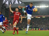 Dominic Calvert-Lewin and Jordan Henderson in action during the Premier League game between Liverpool and Everton on December 10, 2017
