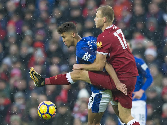Dominic Calvert-Lewin grapples with Ragnar Klavan during the Premier League game between Liverpool and Everton on December 10, 2017
