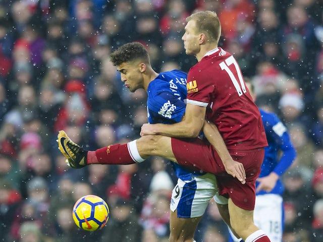 Dominic Calvert-Lewin grapples with Ragnar Klavan during the Premier League game between Liverpool and Everton on December 10, 2017