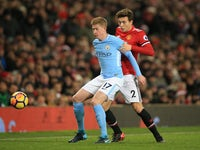 Kevin De Bruyne in action with Victor Lindelof during the Premier League game between Manchester United and Manchester City on December 10, 2017