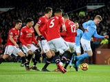 Kevin De Bruyne is marked by United's starting XI during the Premier League game between Manchester United and Manchester City on December 10, 2017