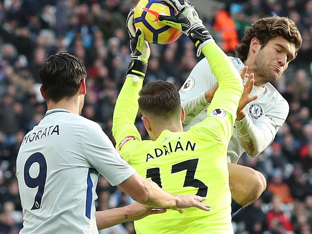 Marcos Alonso elbows Adrian during the Premier League game between West Ham United and Chelsea on December 9, 2017