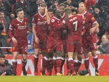 Mohamed Salah celebrates with teammates after scoring the opener during the Premier League game between Liverpool and Everton on December 10, 2017