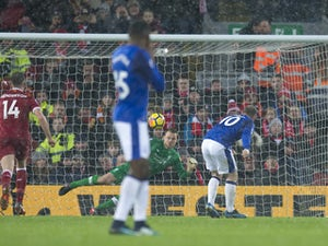 Rooney rescues point in Merseyside derby