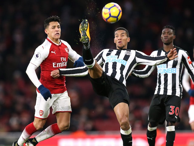 Alexis Sanchez and Isaac Hayden in action during the Premier League game between Arsenal and Newcastle United on December 16, 2017