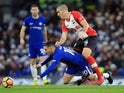 Eden Hazard goes down under Oriol Romeu during the Premier League game between Chelsea and Southampton on December 16, 2017