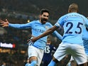 Ilkay Gundogan celebrates scoring the opener with Fernandinho during the Premier League game between Manchester City and Tottenham Hotspur on December 16, 2017