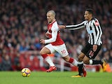 Jack Wilshere and Isaac Hayden in action during the Premier League game between Arsenal and Newcastle United on December 16, 2017