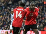 Jesse Lingard and Romelu Lukaku celebrate with each other during the Premier League game between West Bromwich Albion and Manchester United on December 17, 2017