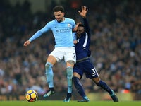Kyle Walker battles with Danny Rose during the Premier League game between Manchester City and Tottenham Hotspur on December 16, 2017