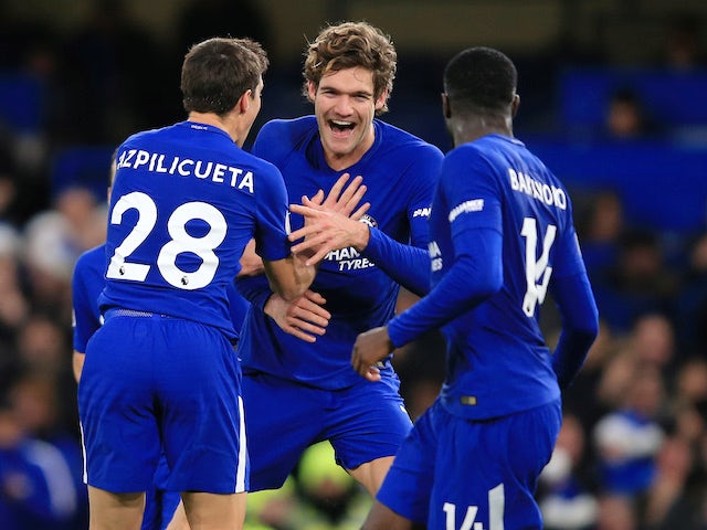 Marcos Alonso celebrates scoring with Cesar Azpilicueta and Tiemoue Bakayoko during the Premier League game between Chelsea and Southampton on December 16, 2017