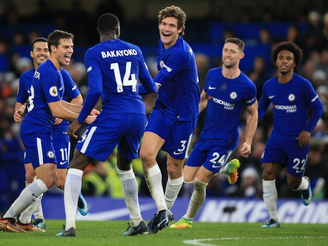 Marcos Alonso celebrates with teammates after scoring during the Premier League game between Chelsea and Southampton on December 16, 2017