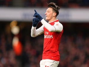 Mesut Ozil celebrates getting the opener during the Premier League game between Arsenal and Newcastle United on December 16, 2017