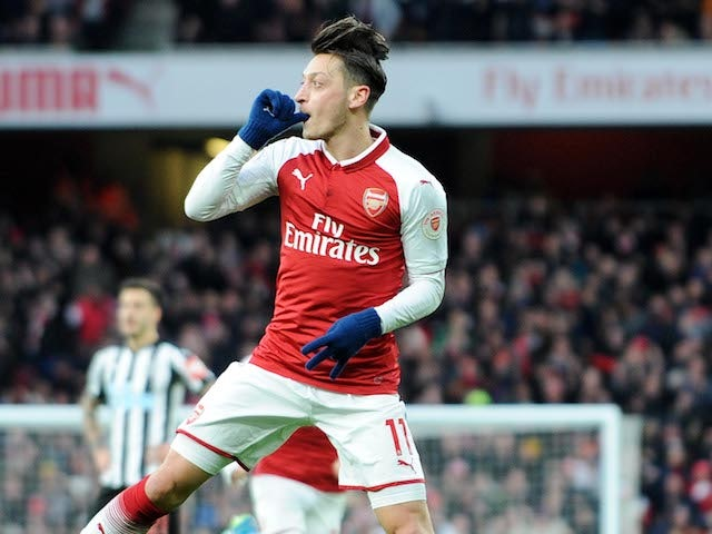 Close-up shot of Mesut Ozil celebrating his opener during the Premier League game between Arsenal and Newcastle United on December 16, 2017