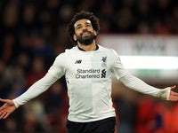 Mohamed Salah celebrates scoring during the Premier League game between Bournemouth and Liverpool on December 17, 2017
