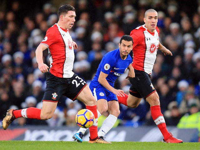 Pedro, Oriol Romeu and Pierre-Emile Hojbjerg in action during the Premier League game between Chelsea and Southampton on December 16, 2017