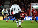 Philippe Coutinho scores the opener during the Premier League game between Bournemouth and Liverpool on December 17, 2017