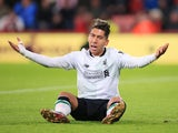 Roberto Firmino reacts to a foul during the Premier League game between Bournemouth and Liverpool on December 17, 2017