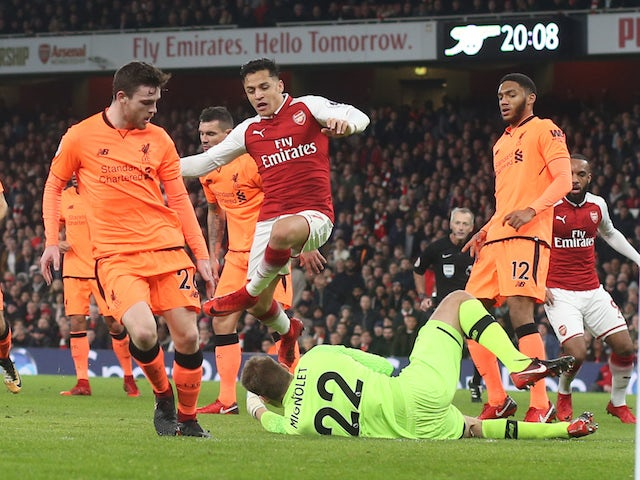 Alexis Sanchez and Simon Mignolet in action during the Premier League game between Arsenal and Liverpool on December 22, 2017