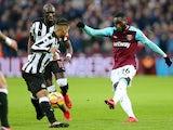 West Ham United's Arthur Masuaku shoots past Newcastle United players in the Premier League on December 23, 2017