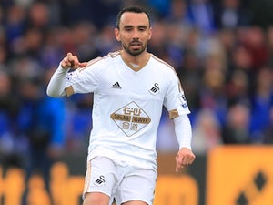 Swansea legend Britton announces retirement