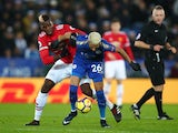 Paul Pogba and Riyad Mahrez during the Premier League match between Leicester City and Manchester United on December 23, 2017