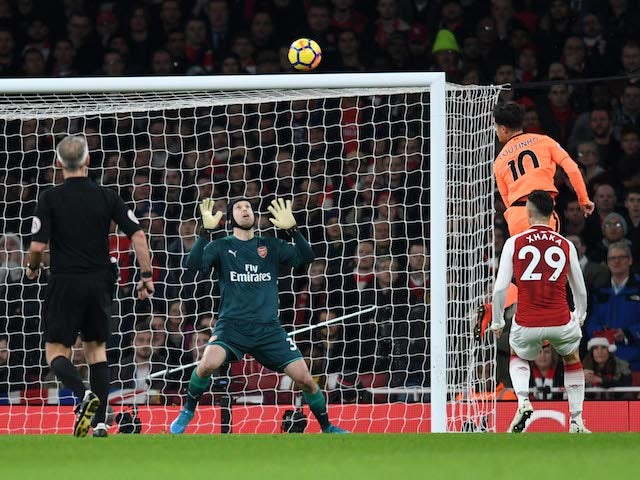 Philippe Coutinho heads in past Petr Cech during the Premier League game between Arsenal and Liverpool on December 22, 2017