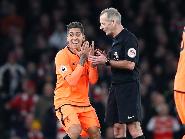 Roberto Firmino protesteth during the Premier League game between Arsenal and Liverpool on December 22, 2017