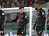 Alexis Sanchez asks Alexandre Lacazette where his team were during his goal celebration during the Premier League game between Crystal Palace and Arsenal on December 28, 2017