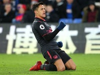 Alexis Sanchez celebrates scoring his side's third during the Premier League game between Crystal Palace and Arsenal on December 28, 2017