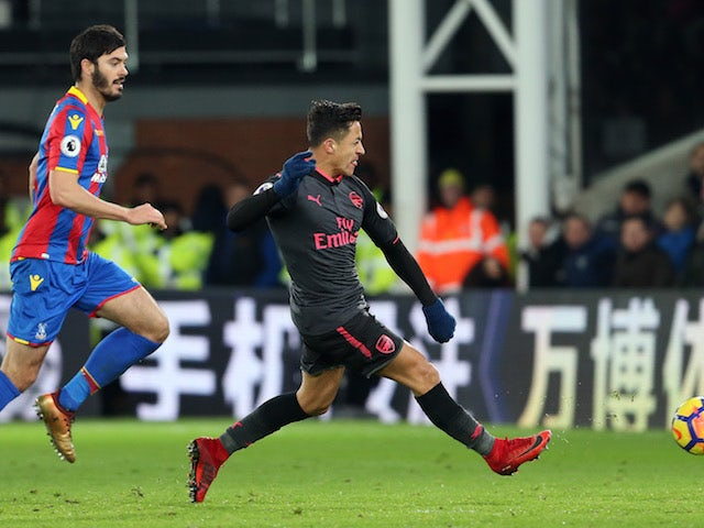 Alexis Sanchez scores the Gunners' third during the Premier League game between Crystal Palace and Arsenal on December 28, 2017