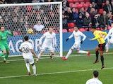 Andre Carrillo scores the opener during the Premier League game between Watford and Swansea City on December 30, 2017