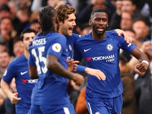 Antonio Rudiger celebrates with teammates after scoring during the Premier League game between Chelsea and Stoke City on December 30, 2017