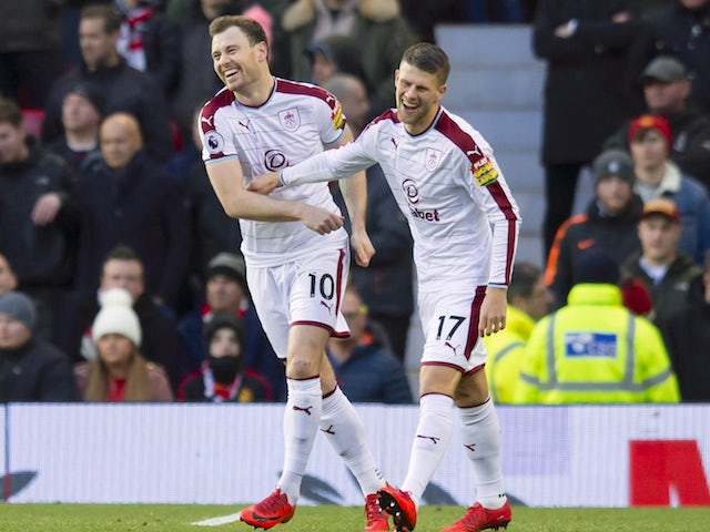 Ashley Barnes celebrates with Johann Berg Gudmundsson during the Premier League game between Manchester United and Burnley on December 26, 2017