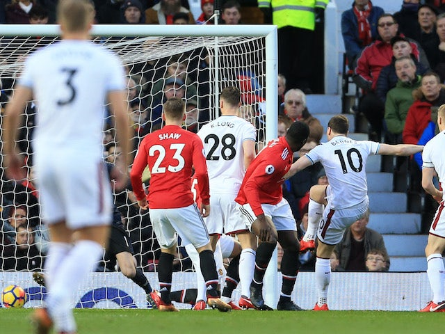 Ashley Barnes scores the opener during the Premier League game between Manchester United and Burnley on December 26, 2017