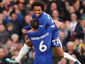 Danny Drinkwater celebrates with Willian after scoring the second during the Premier League game between Chelsea and Stoke City on December 30, 2017