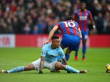 Gabriel Jesus and Andros Townsend in action during the Premier League game between Crystal Palace and Manchester City on December 31, 2017