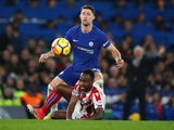 Gary Cahill looms over Saido Berahino during the Premier League game between Chelsea and Stoke City on December 30, 2017