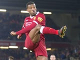 Georginio Wijnaldum has a shot during the Premier League game between Liverpool and Swansea City on December 26, 2017