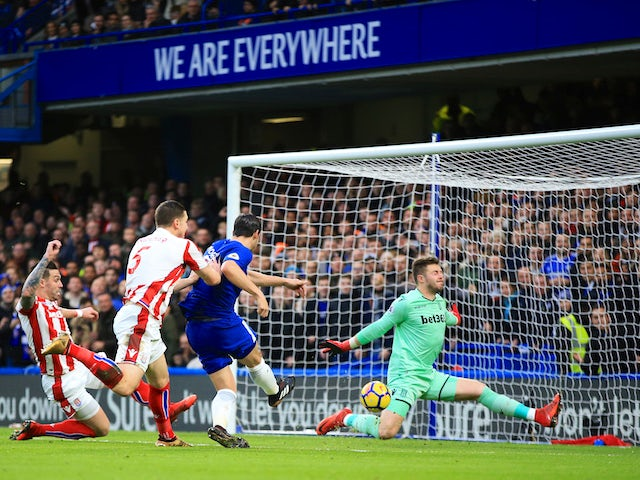 Jack Butland saves Alvaro Morata's shot during the Premier League game between Chelsea and Stoke City on December 30, 2017