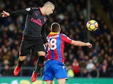 Jack Wilshere and James McArthur in action during the Premier League game between Crystal Palace and Arsenal on December 28, 2017