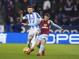 Johann Berg Gudmundsson and Scott Malone in action during the Premier League game between Huddersfield Town and Burnley on December 30, 2017