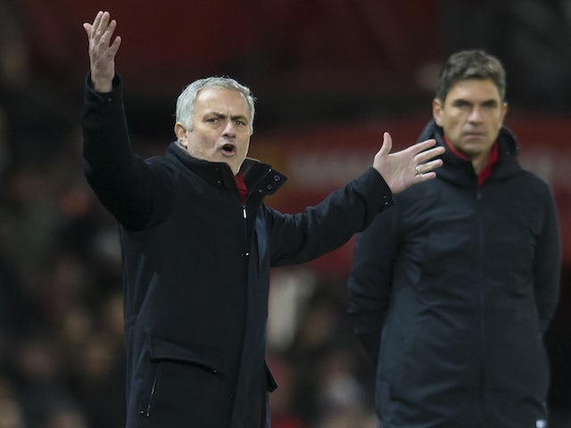 Jose Mourinho reacts as Mauricio Pellegrino watches on during the Premier League game between Manchester United and Southampton on December 30, 2017
