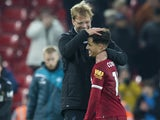 Jurgen Klopp congratulates Philippe Coutinho after the Premier League game between Liverpool and Swansea City on December 26, 2017