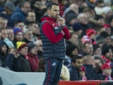 Caretaker manager Leon Britton watches on during the Premier League game between Liverpool and Swansea City on December 26, 2017