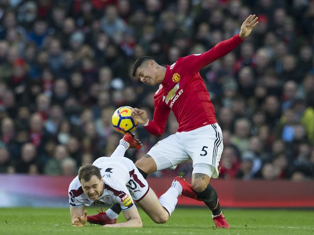 Marcos Rojo and Ashley Barnes in action during the Premier League game between Manchester United and Burnley on December 26, 2017