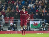 Philippe Coutinho celebrates scoring the opener during the Premier League game between Liverpool and Swansea City on December 26, 2017