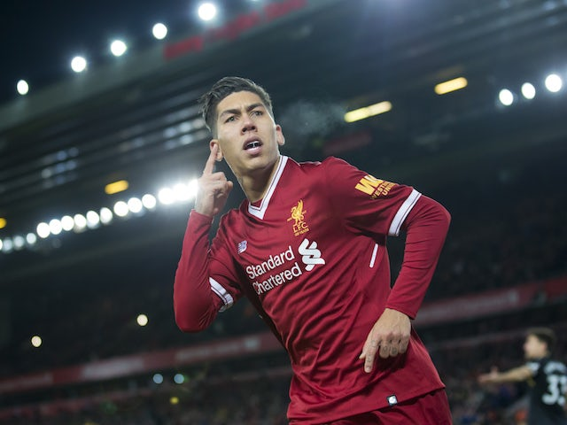 Roberto Firmino celebrates scoring during the Premier League game between Liverpool and Swansea City on December 26, 2017